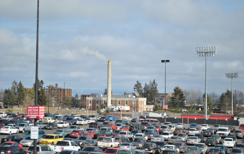 Should the university provide students with more free parking lots and a shorter walk?