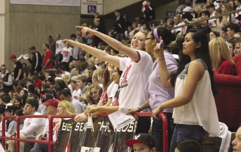 Volleyball players Allison Doerpinghaus, Kellen Barfield and Talia Fernandez cheer on the Eagle men.