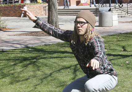 Eastern students practice slacklining outside of the PUB