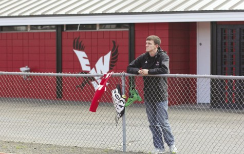 Photo illustration by Anna Mills Senior sprinter Brad Wall looks upon the track he has dominated during his career at Eastern. He was named Big Sky Champion five times in his career.