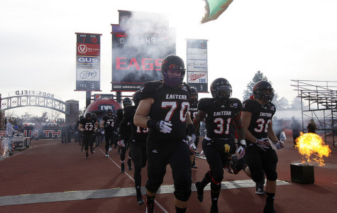 TJ Lee leads the Eagles on to the field during his senior season.