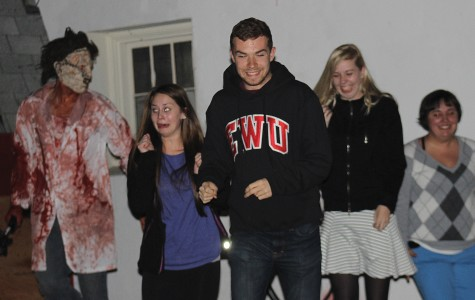Photo by Karissa Berg  Leatherface strikes terror in students during the Oct. 24-25 haunted house.