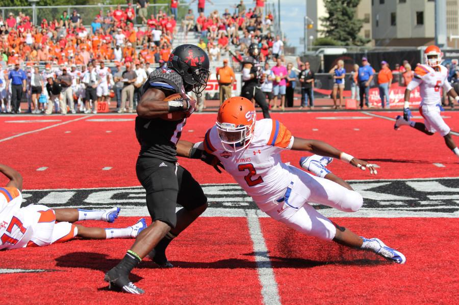 Michael Wade, player 2 from Sam Houston, attempts to grab the football from an EWU Eagle.