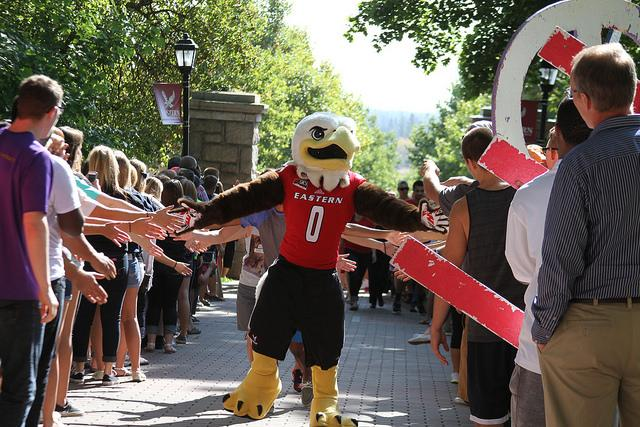 Swoop, EWU mascot, leads new students toward Showalter Hall at the Passing Through The Pillars event on Sept. 22