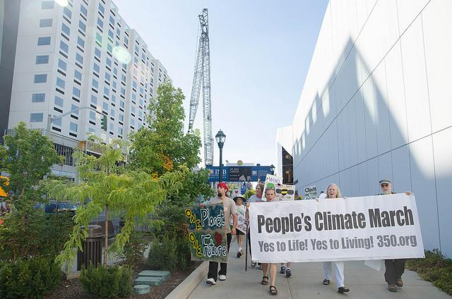 Protesters march by the Spokane Convention Center during the People's Climate March.