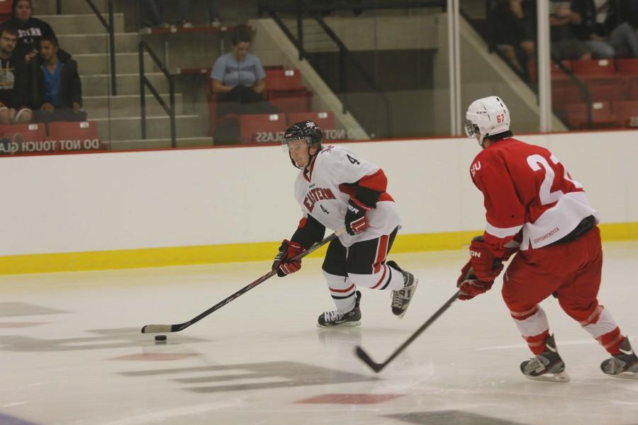 Brandon Wilbert keeps the puck away from a competing player.