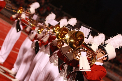 EWU marching bands brass line up for a football game.