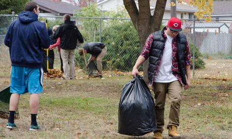 """Hector Zavala, an EWU Freshman and member of Beta Theta Pi, volunteers at the """"Rake a Difference event on Oct. 28"""