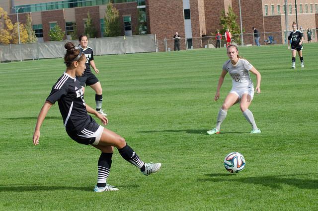 Freshman M'Kenna Hayes kicks the ball down the field.