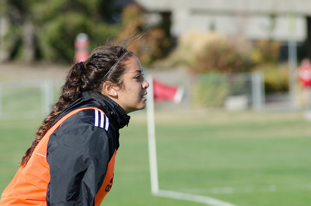 Aiko Johnson cheers on her teammates during the match up against The Idaho Vandals.