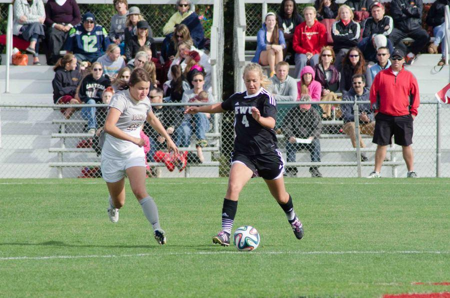 Savannah Hoekstra dribbles the ball downfield in the Oct. 12 conference game.