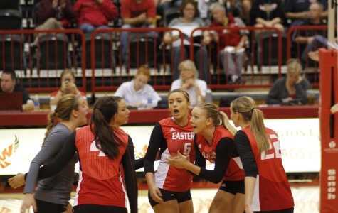 The volleyball team celebrates after they score a point during the game against Idaho.