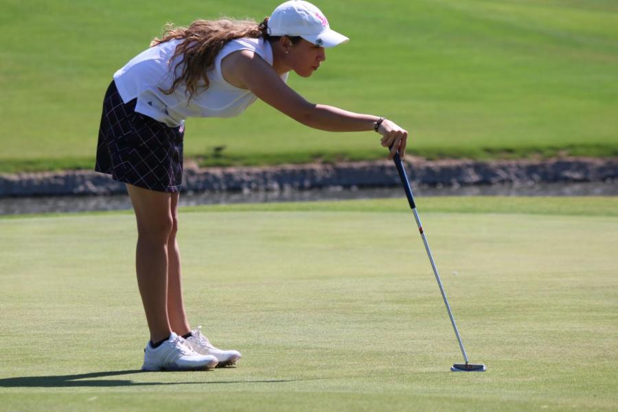 Taylor Crandall contemplates her next stroke on the green at the Tacoma Country and Golf Club in Tacoma, Washington.