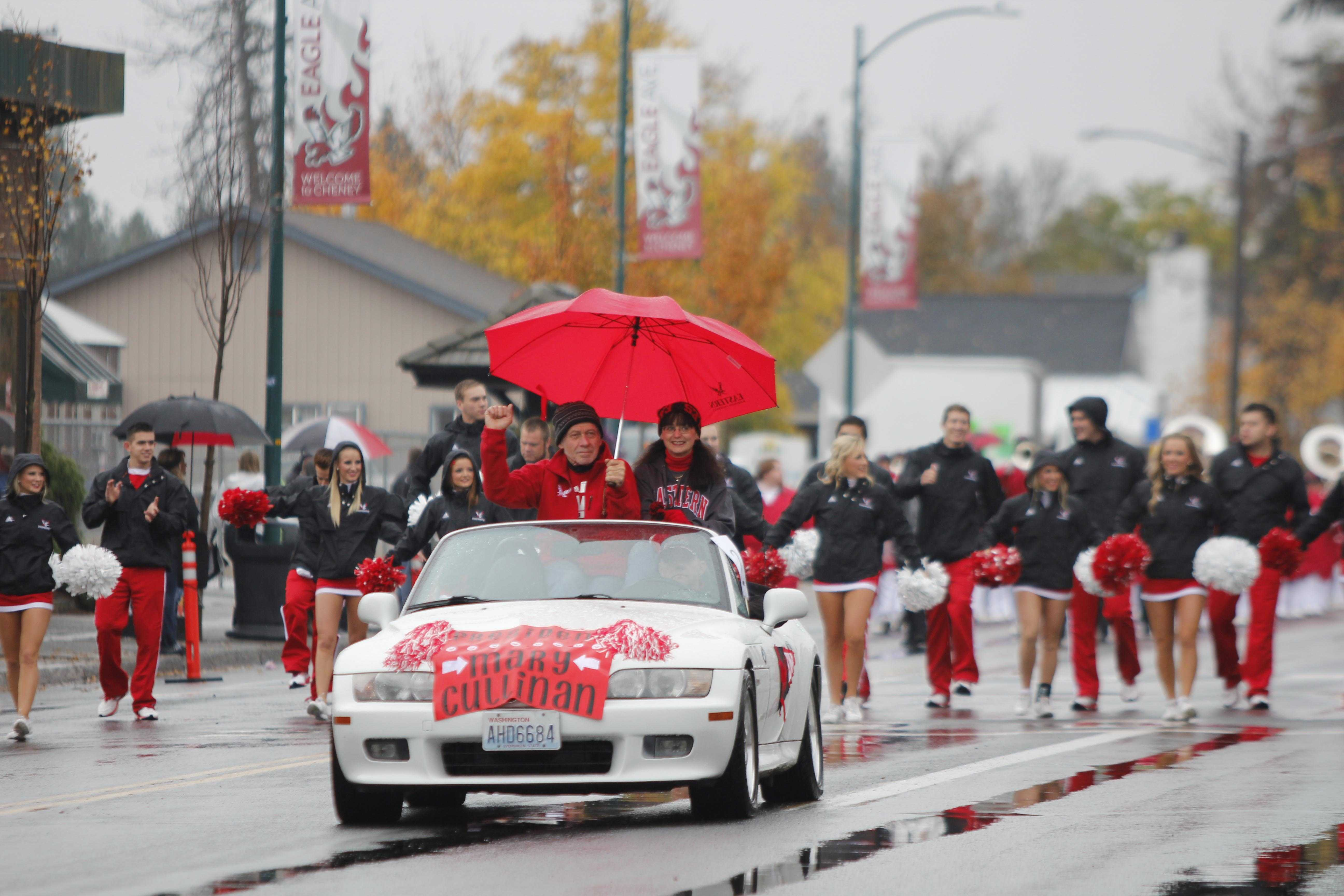 Eastern President Mary Cullinan shows her school spirit depute the rain as a part of the Homecoming Parade in downtown Cheney Nov. 1.