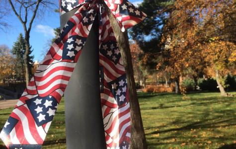 Flag ribbons tied to a pole on campus in rememberance.