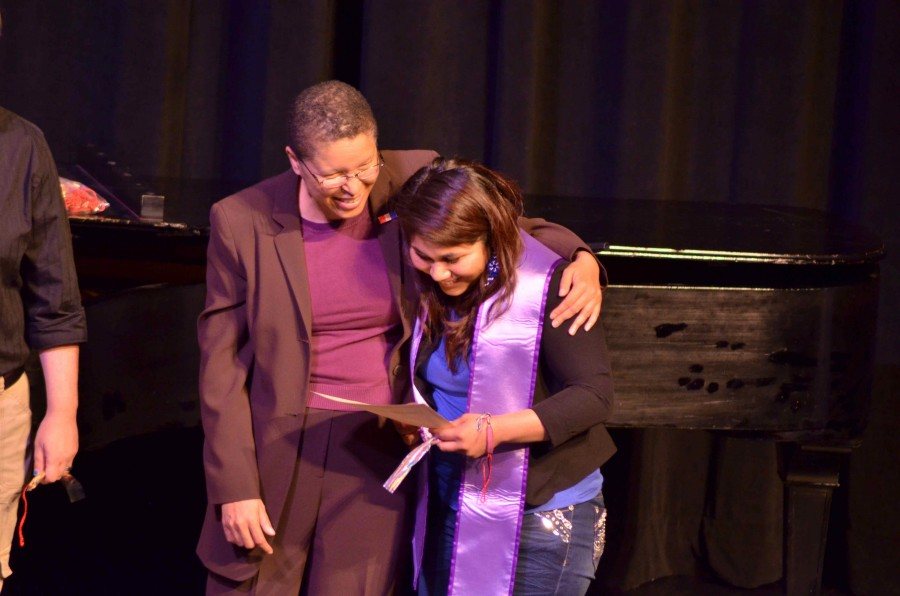 Sandy Williams, Eastern's Pride Center coordinator, hugs an EWU Lavender Graduate as they obtain their certificate in Showalter Auditorium on May 8.