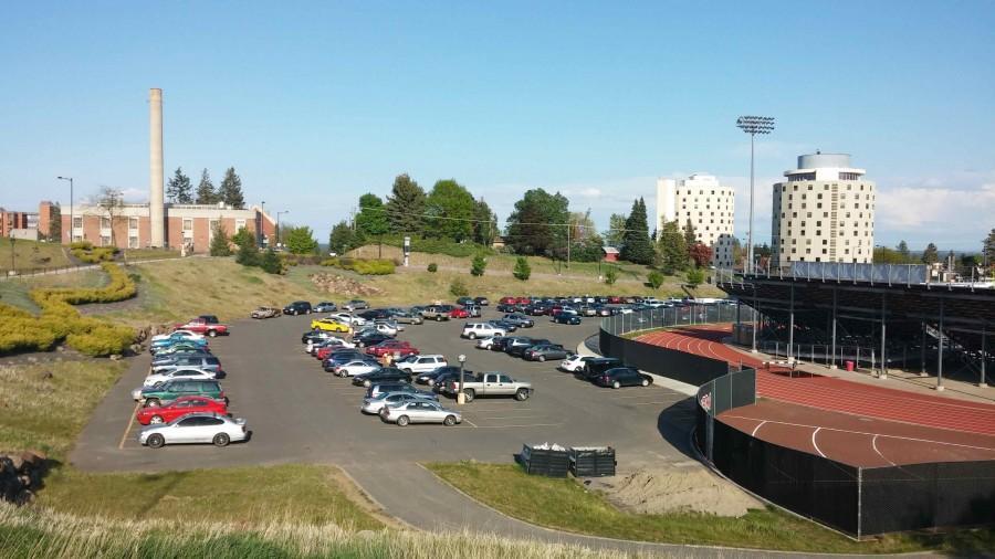 Many vehicles park in lot 16 near Roos Field along Washington Ave.