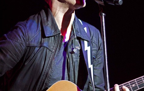 Andy Grammer performs with his guitar during the EWU concert at Reese Court on June 1.