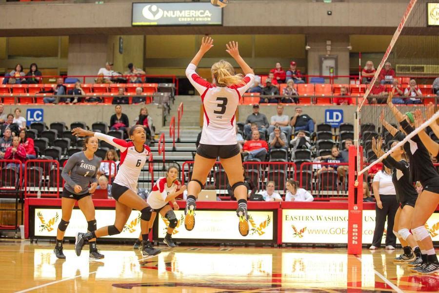 Despite roadblocks, volleyball started the season strong. Sophomore Nicole Rigoni sets ball for senior Alexis Wesley.
