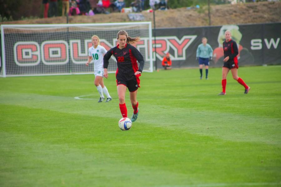 Emily Bringgold dribbles the ball down the field during the Oct. 23 game.