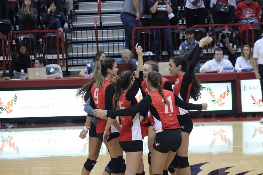 Teammates celebrate at home against Montana State.