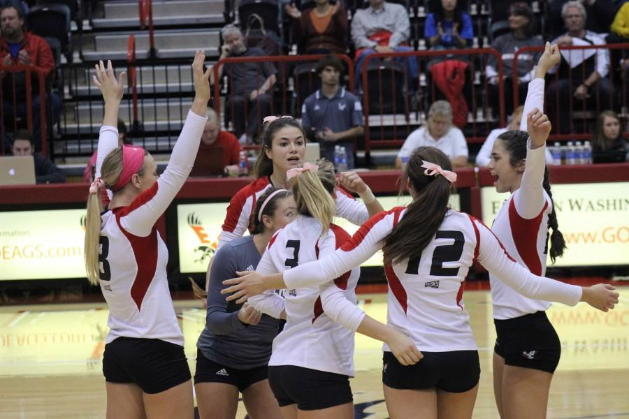 Team celebrates after a point. Beating Montana state 3-2.