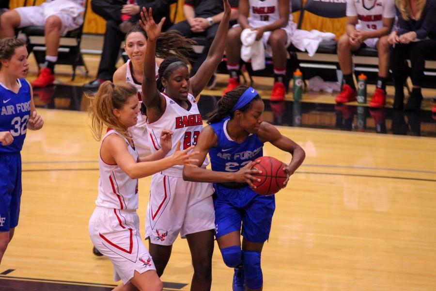 Amira Chandler and Mariah Cunningham putting pressure on an Air Force player.