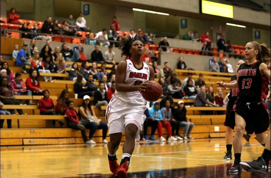 Violet Kapri Morrow going to the rim against Saint Martins in an exhibition.