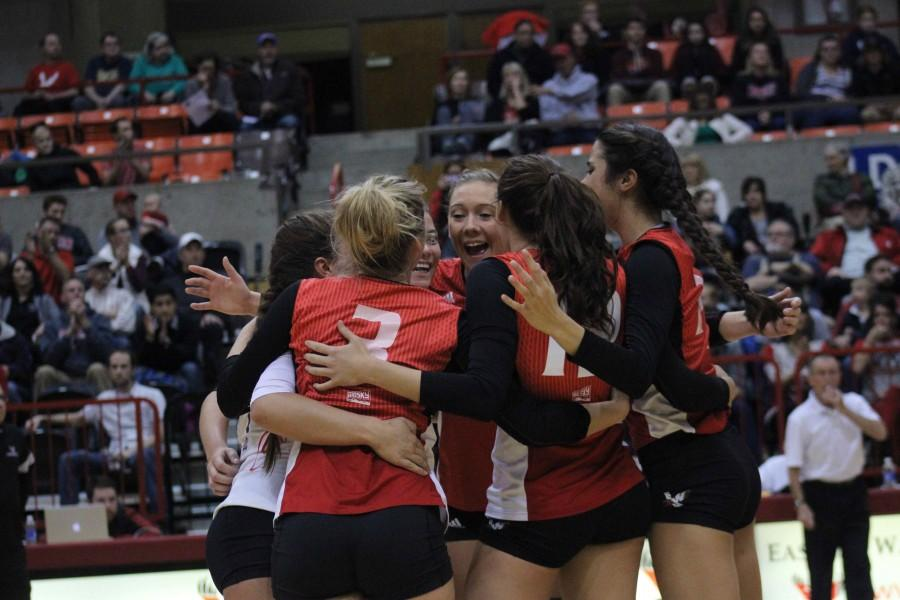 Eagles volleyball team celebrates.
