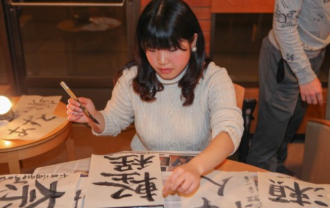 Kyoko Kageyama teaches students how to paint Japanese letters.