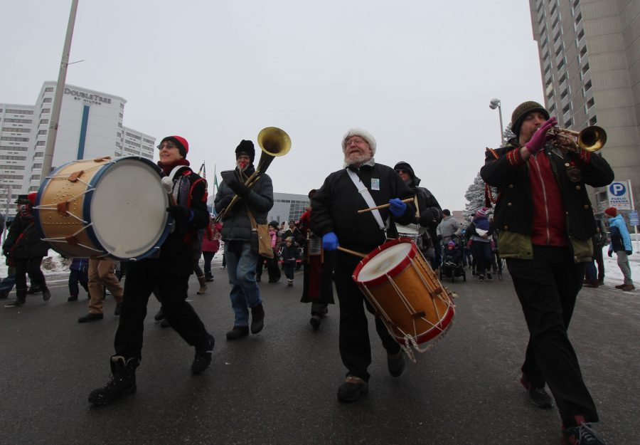 The+P-Jammers+band+energizes+the+crowd+as+they+march+through+the+streets+of+downtown+Spokane.