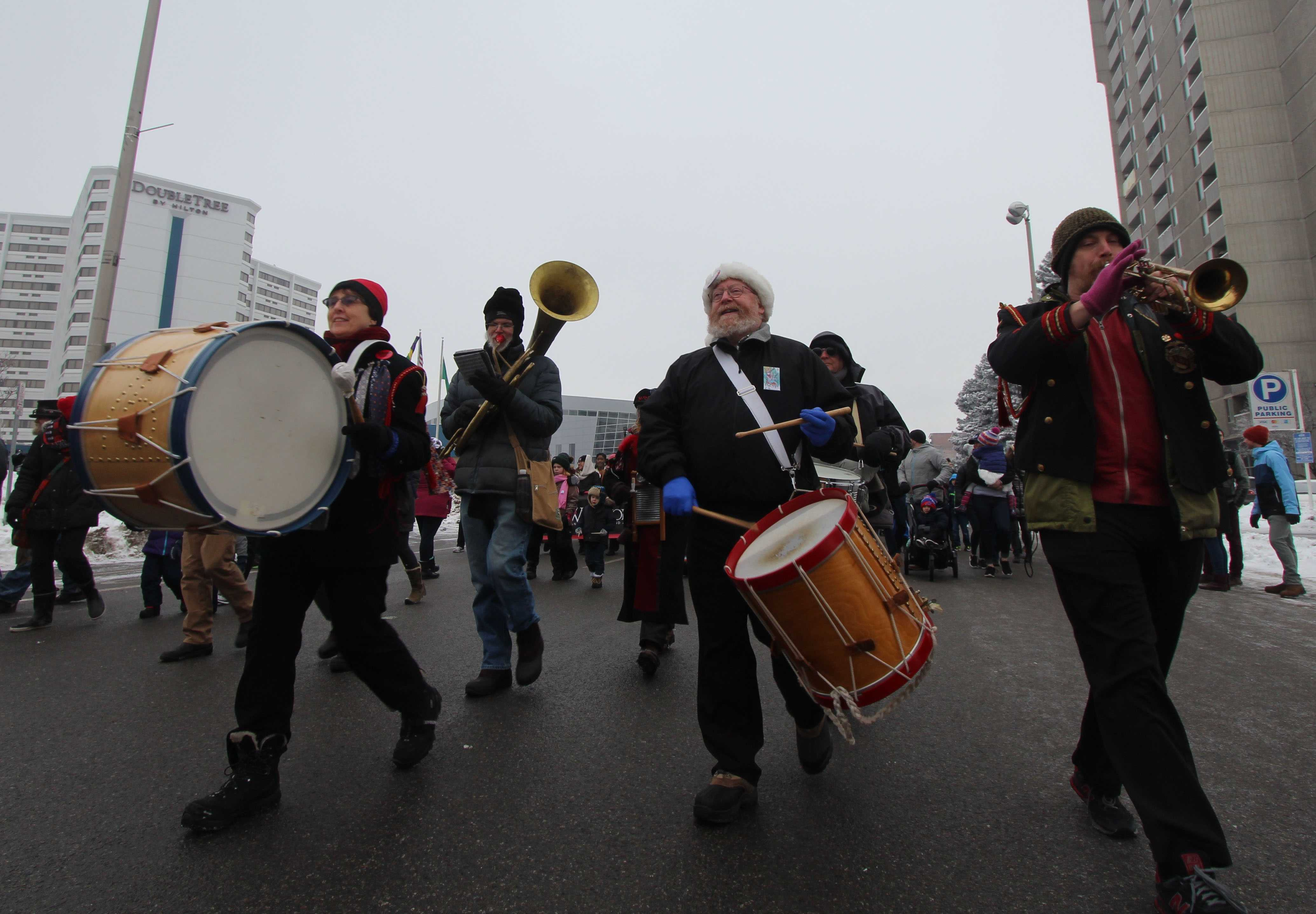 The P-Jammers band energizes the crowd as they march through the streets of downtown Spokane.