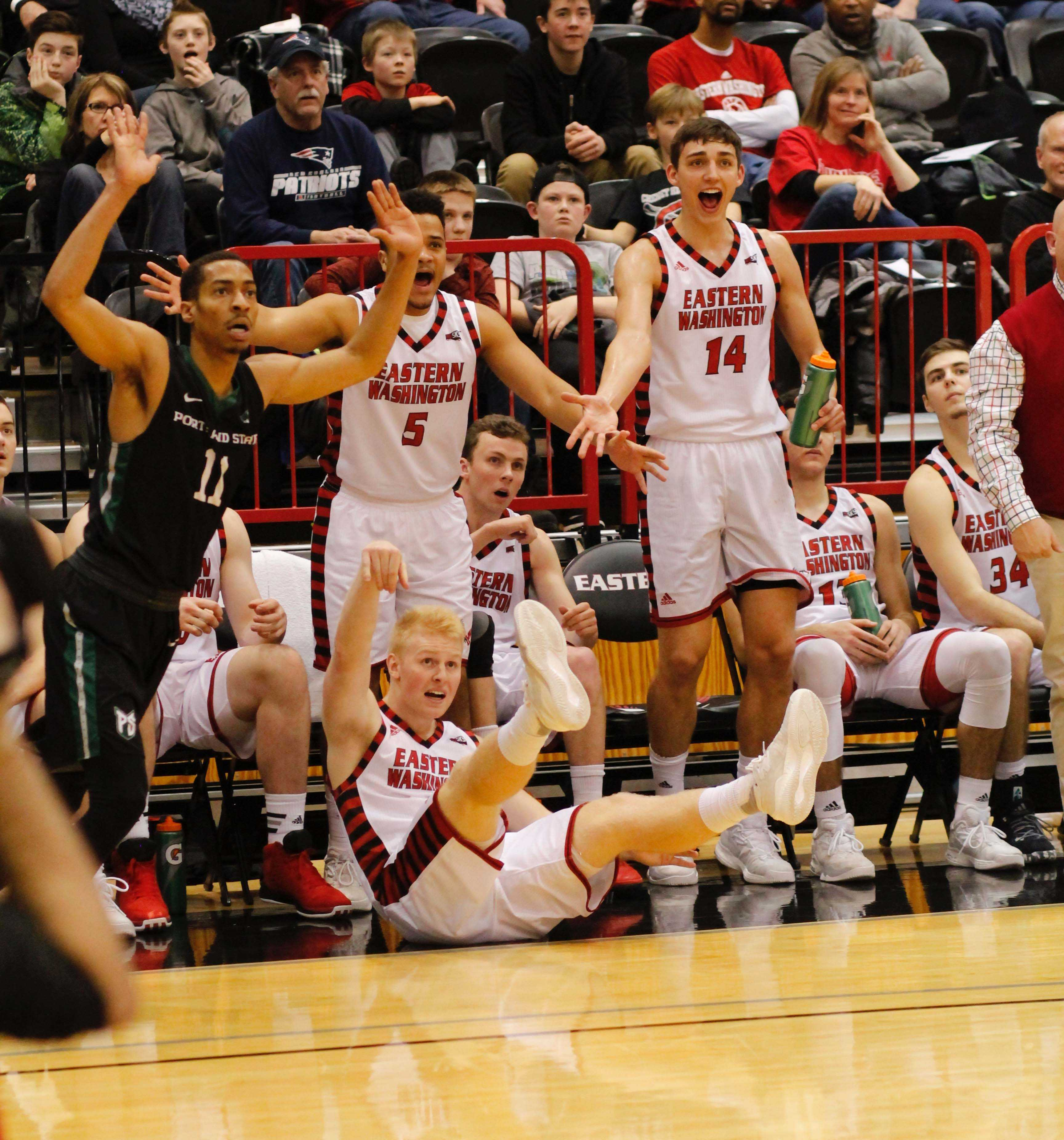 Sophomore+guard+Ty+Gibson+draws+a+foul+on+a+three+point+attempt+in+front+of+the+EWU+bench+against+Portland+State%2C+Feb.+4%2C+2017%2C+at+Reese+Court.