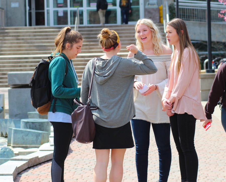 (On right) ASEWU candidates Maddisen McNeill and Kennedy Bailey speak with students at the meet and greet at the Campus Mall.