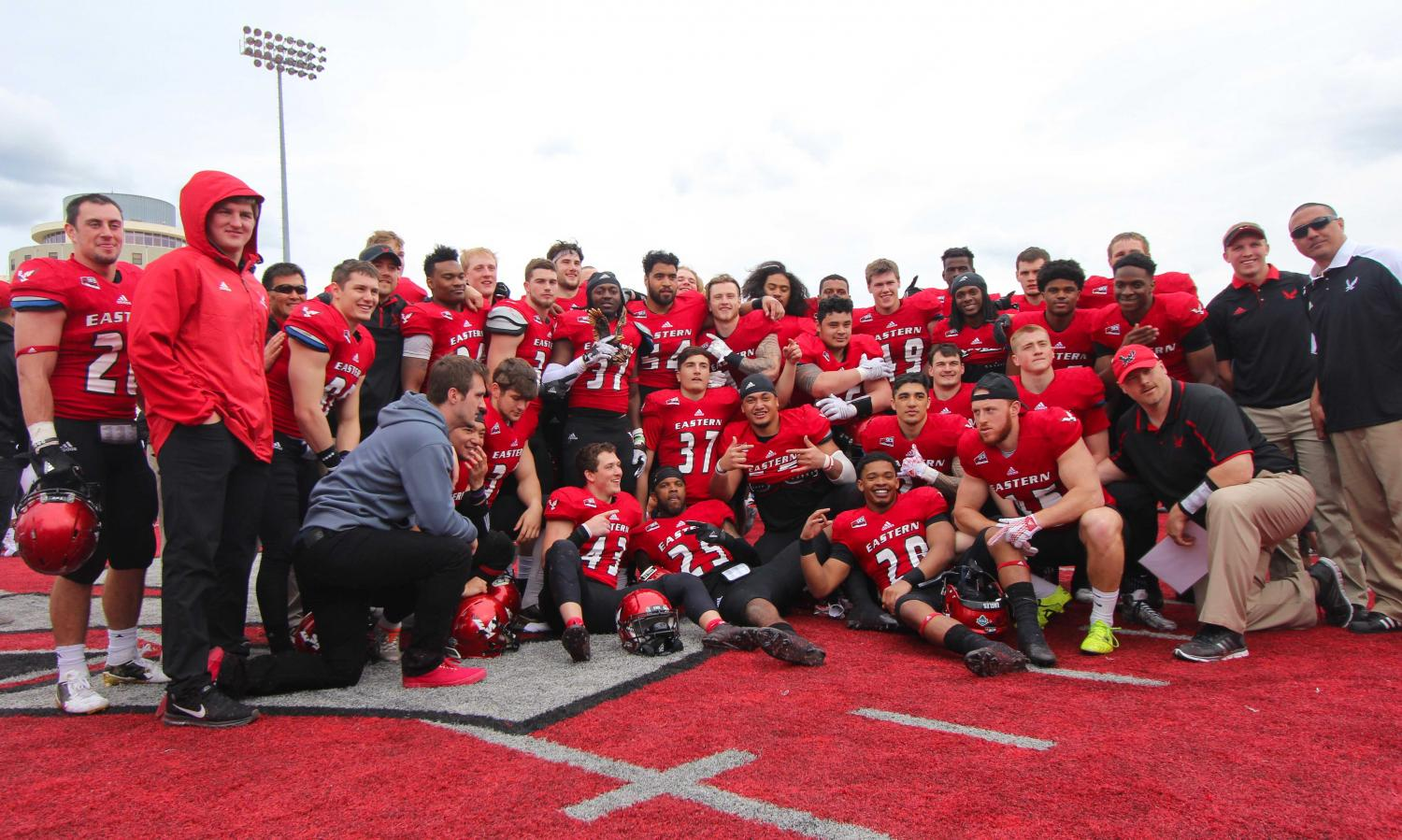 Players on Team Red pose for a picture after their win in the annual Red-White Spring Game
