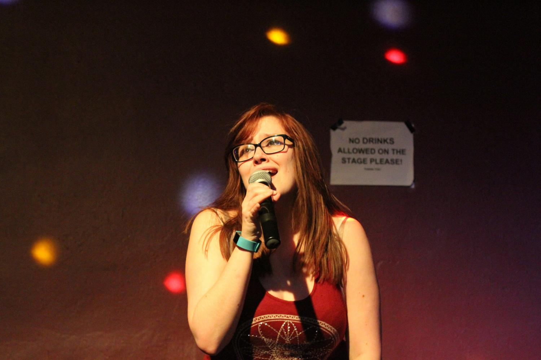 Sabrina Mauldin singing at Eagle's Pub's karaoke