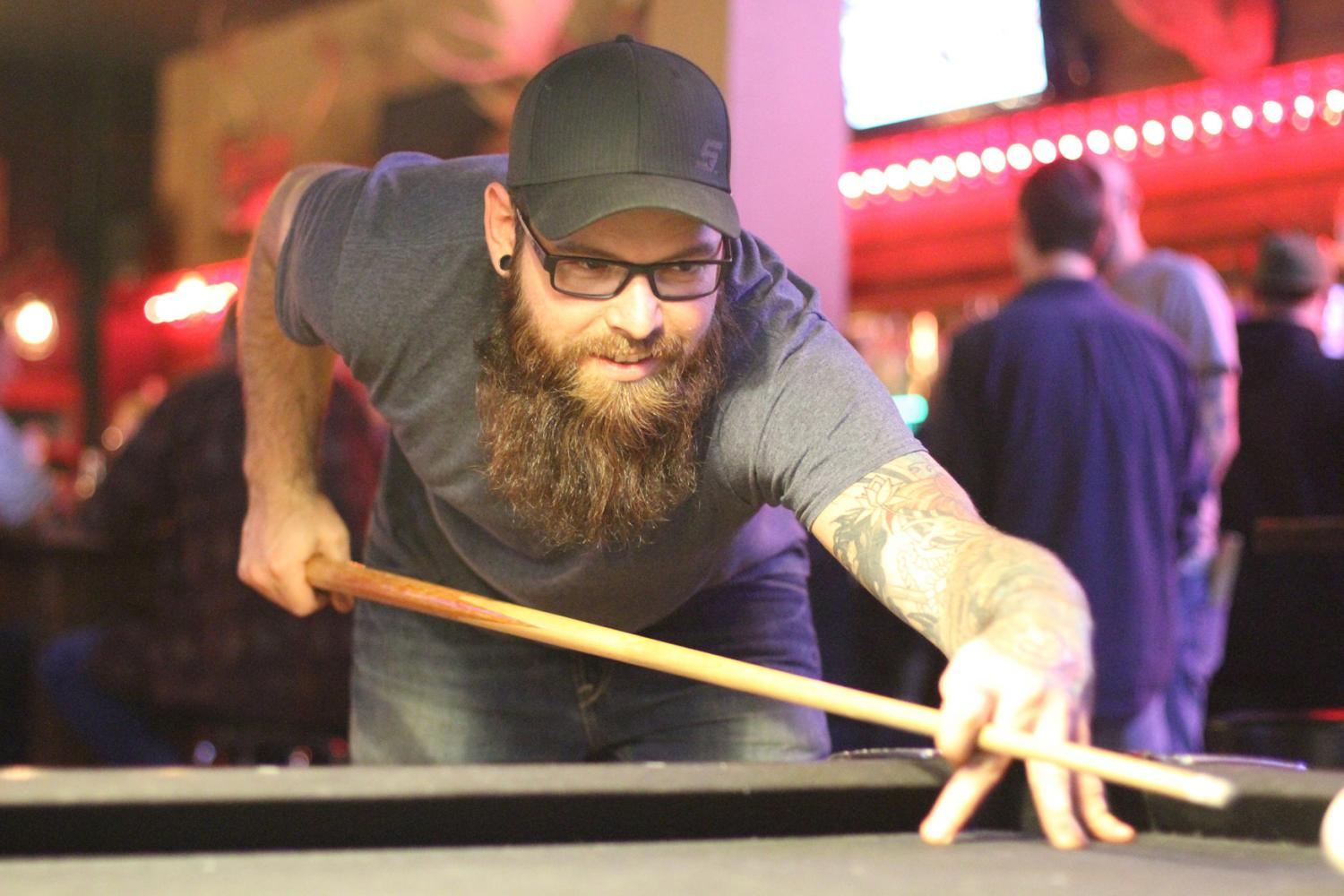 Mike Carson playing pool at Wild Bill's Longbar