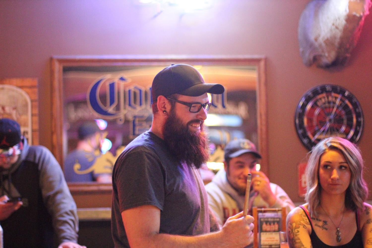 Mike Carson smiling with his friends while playing pool at Wild Bill's Longbar