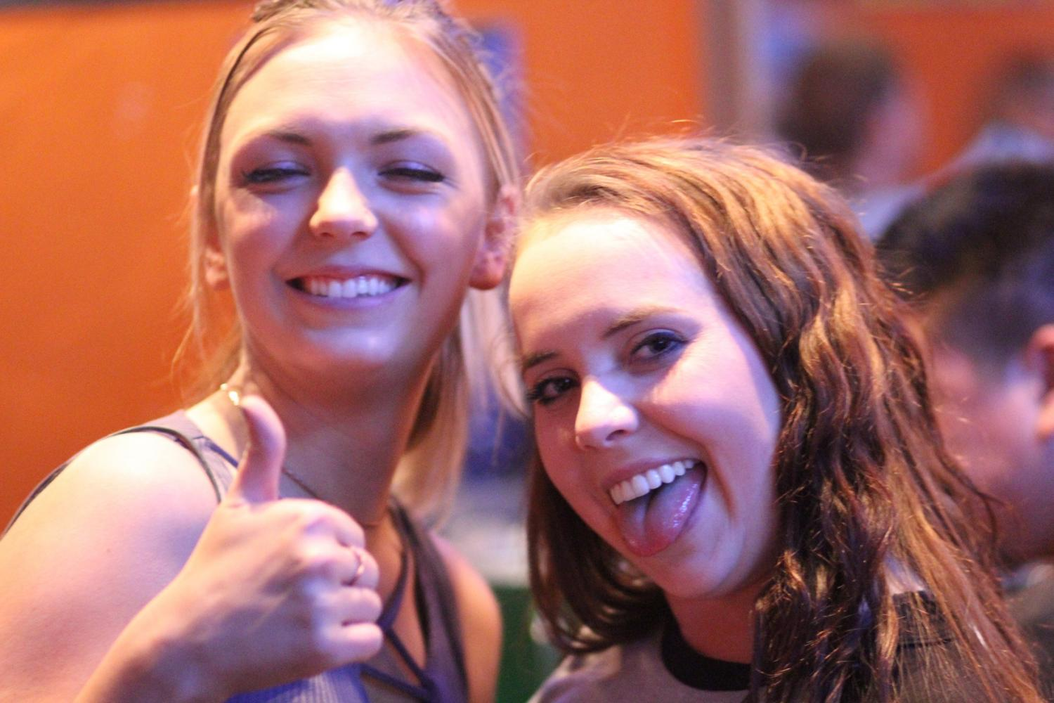 Kylie Stark (left) and Kayla Willms smiling at Monterey's Pub & Grub