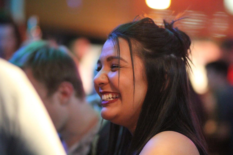 Senior Chelsie Rogerson smiling with her friends at Monterey's Pub & Grub