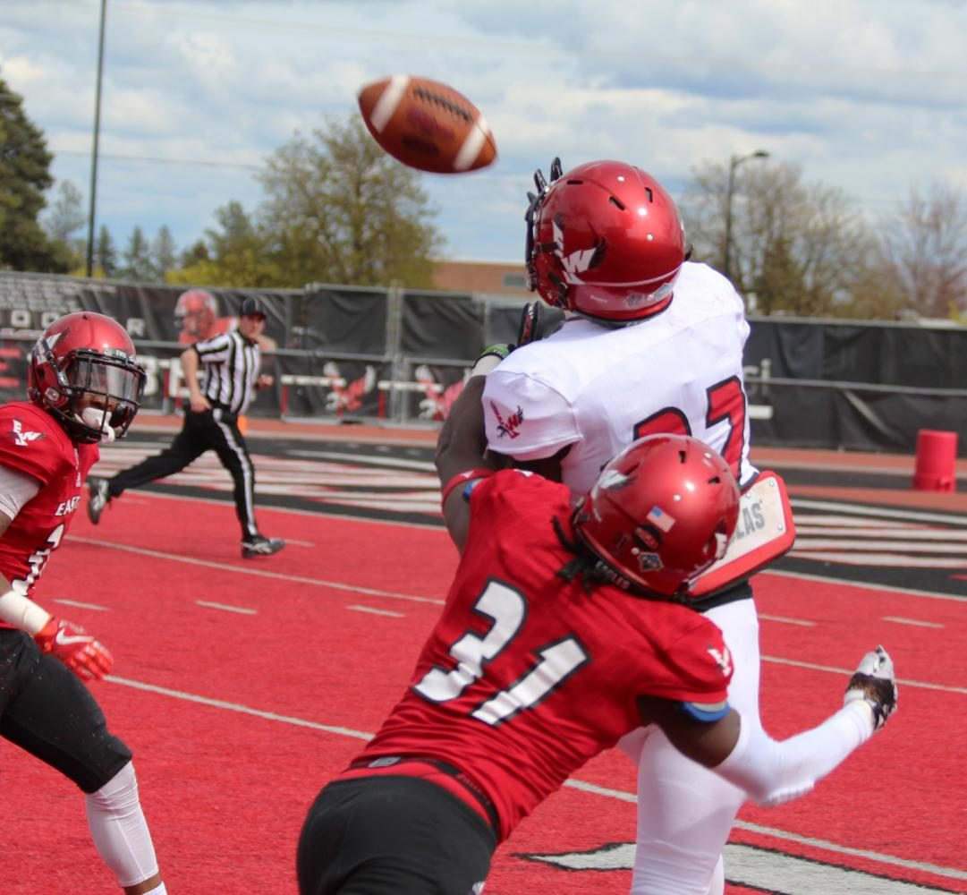 Wide receiver Xavier James (82) makes a catch over defensive back Brandon Montgomery (31), at the Red-White spring game.