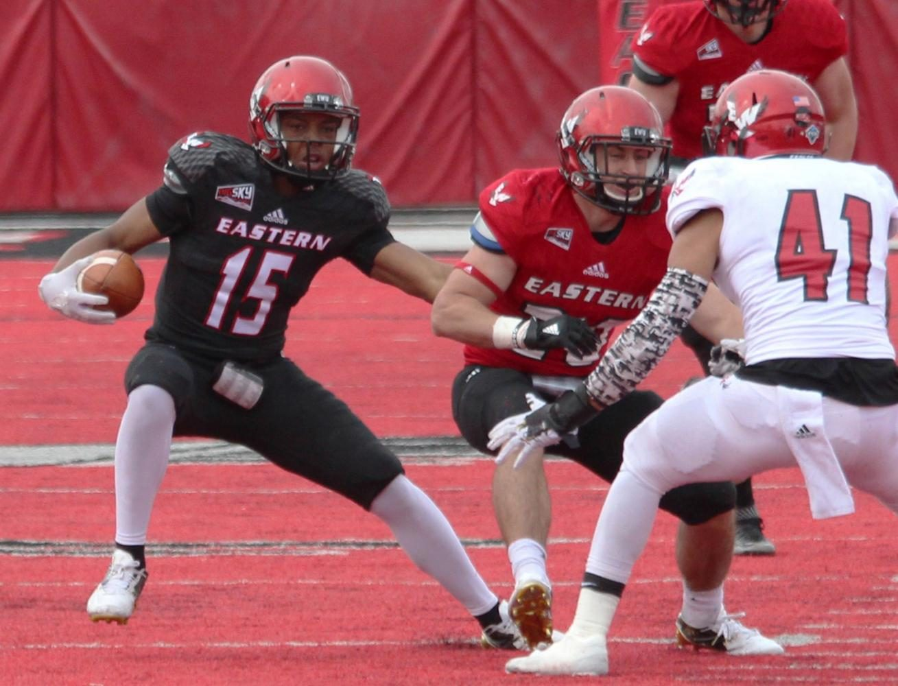 Quarterback Eric Barriere (9) scrambles, at the Red-White spring game.