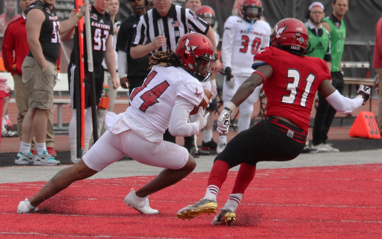 Wide receiver Jayson Williams (14) makes a catch and tries to get around defensive back Brandon Montgomery (31), at the Red-White spring game.