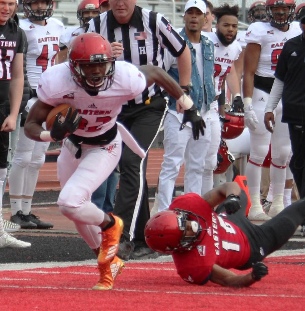 Wide receiver Xavier James (82) breaks a tackle after making a catch, at the Red-White spring game.