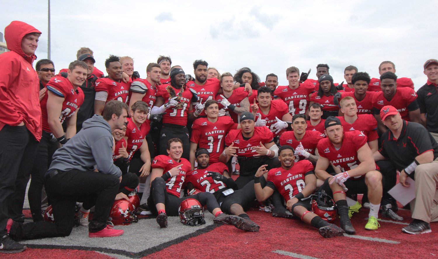 The victorious red team  (24-17) posing for a photo after the Red-White spring game.