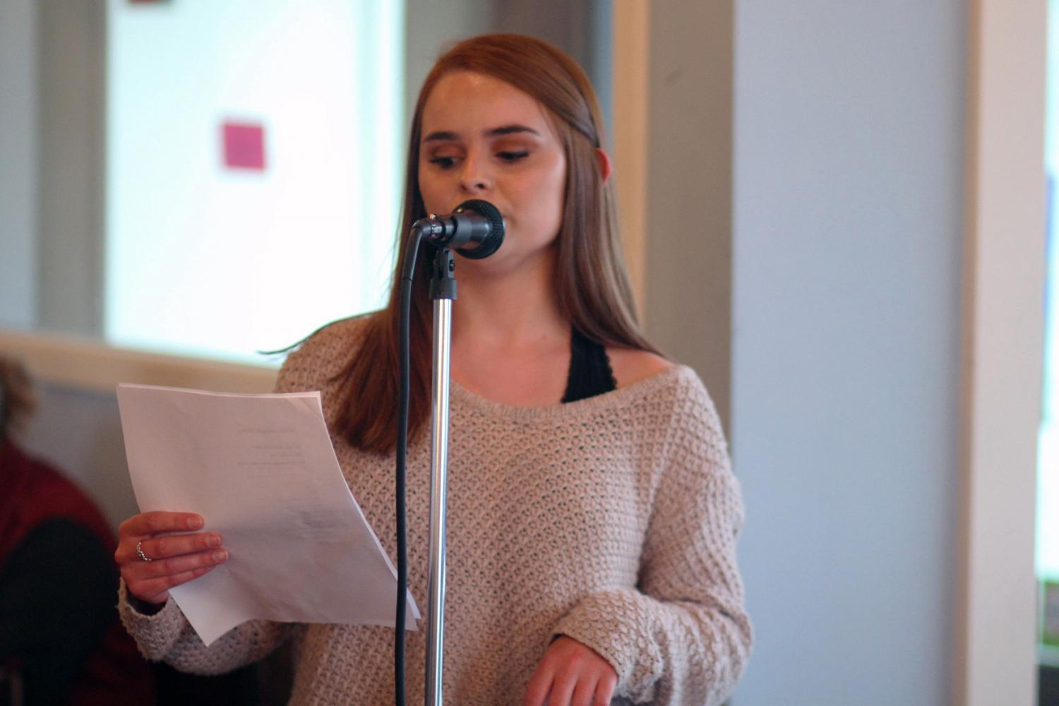 Junior Sarah Boland reading her own poetry at The Mason Jar's open mic night