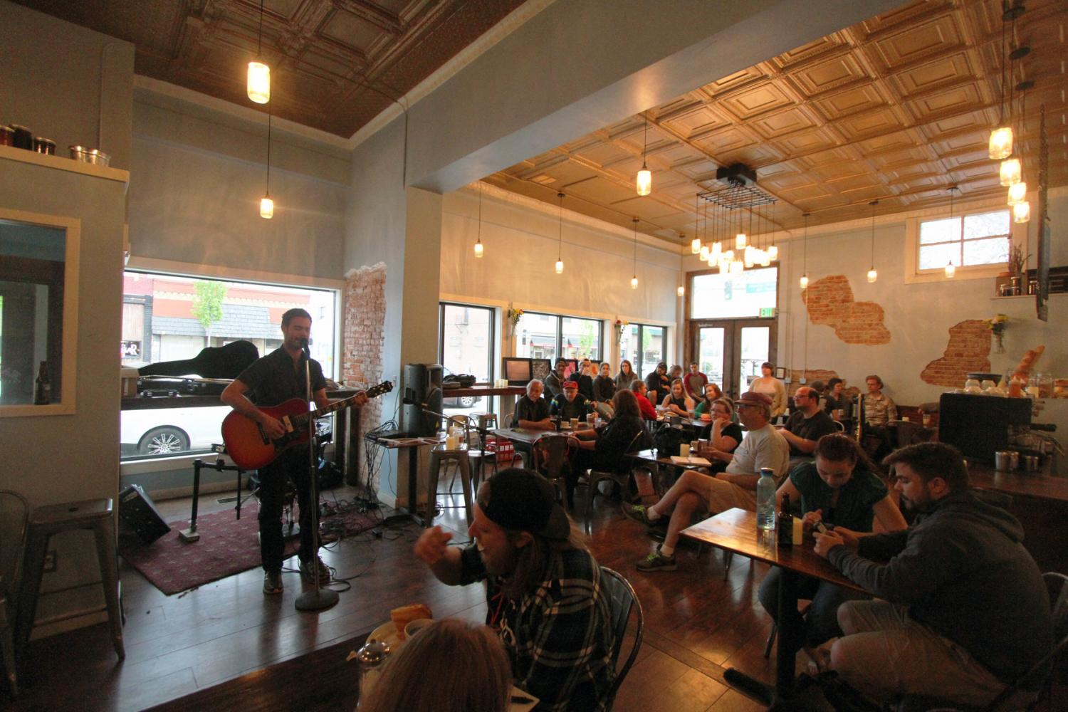 William Nover performing to a packed audience at The Mason Jar's open mic night