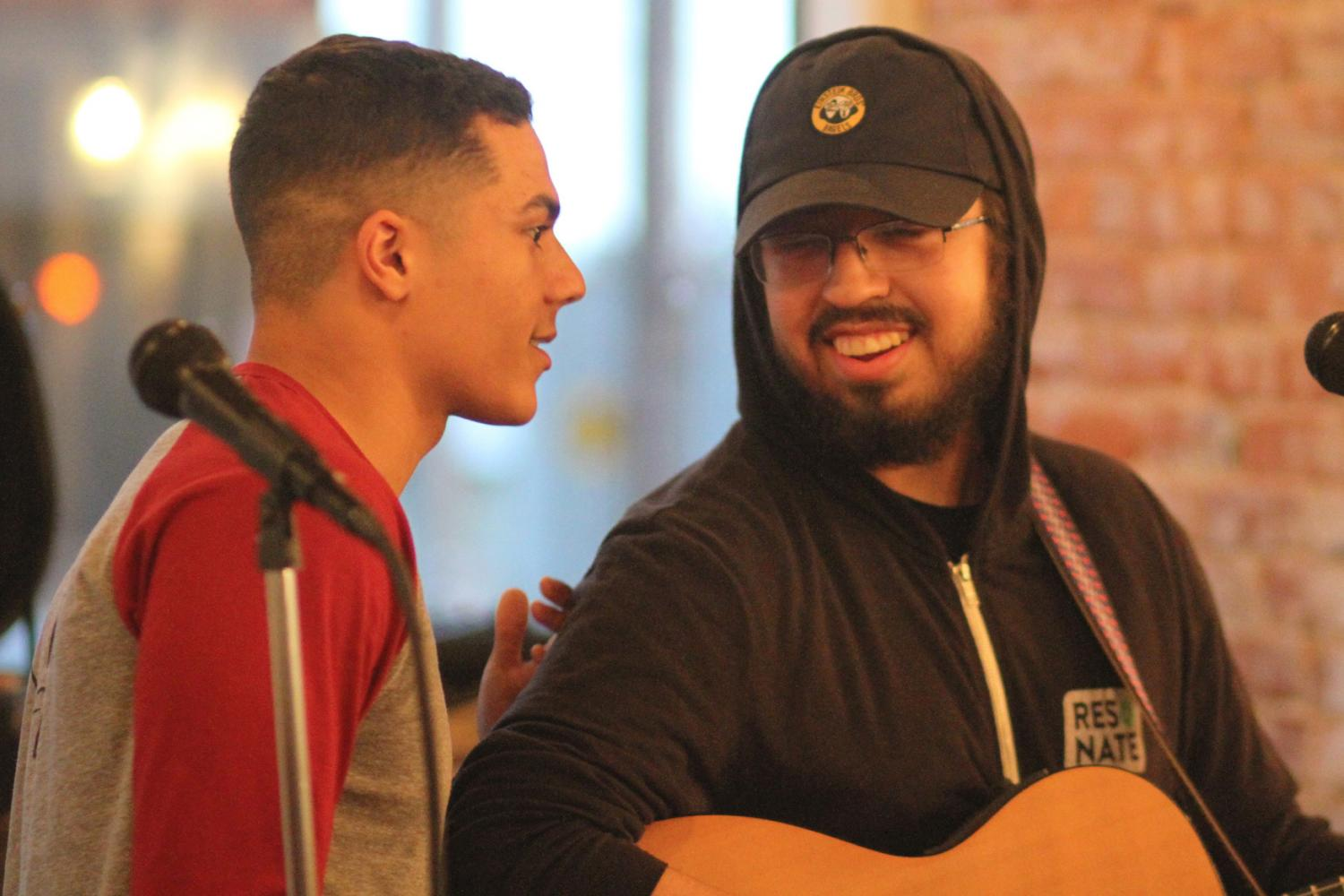 Avery Johnson (Left) and Reuben Soliz (right) performing slam poetry together at The Mason Jar's open mic night
