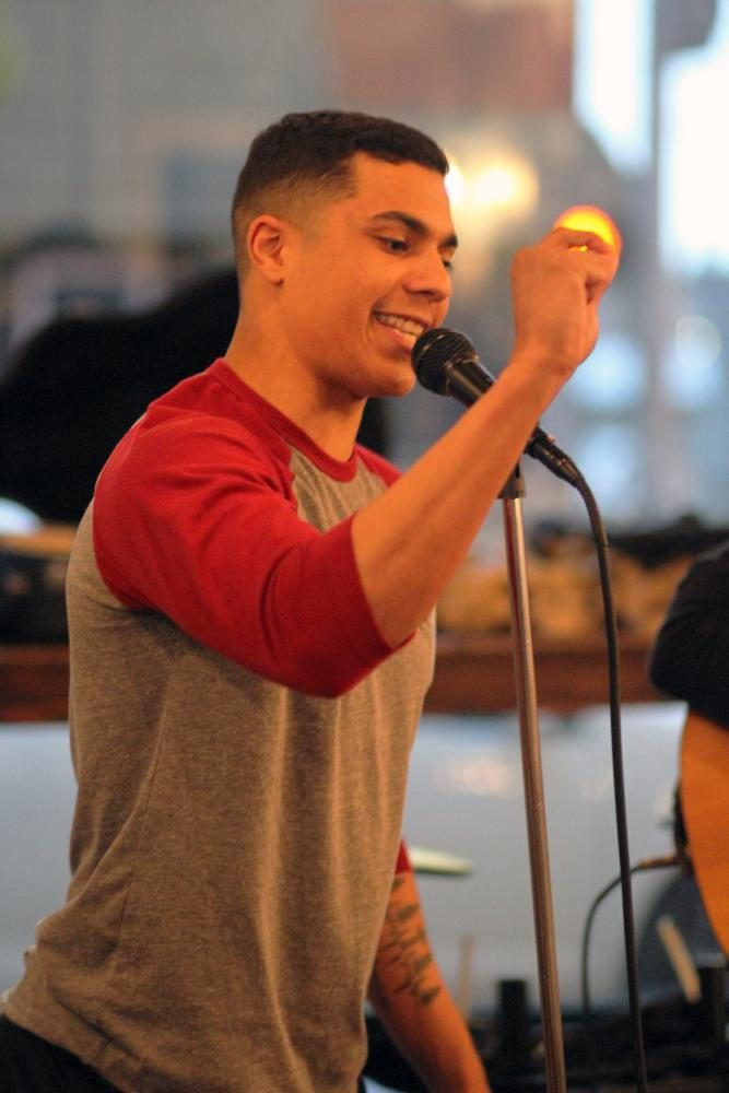 Avery Johnson performing slam poetry at the Mason Jar's open mic night
