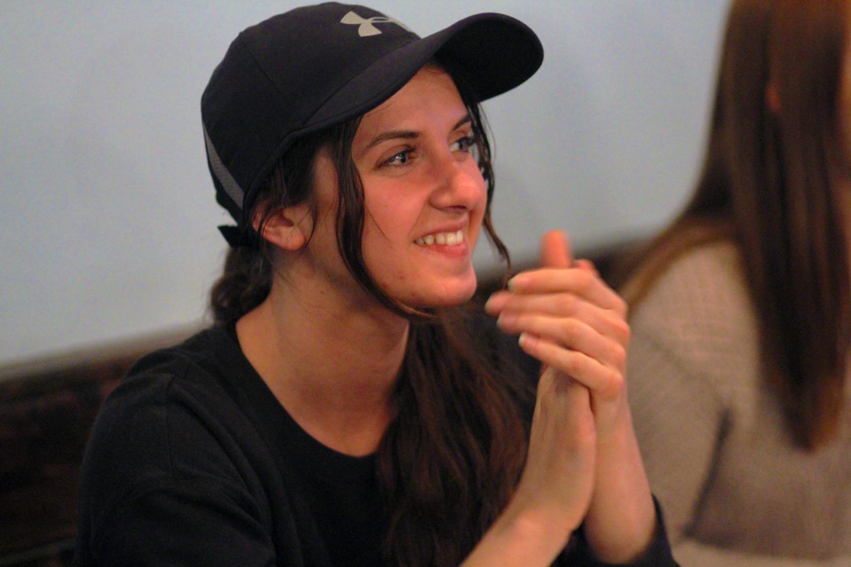 Senior Kaltrina Ferati smiling at the slam poetry performance at the Mason Jar's open mic night